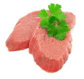 Viande coupée en tranches par deux avec la lame du persil vert photo stock