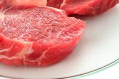 Viande crue sur le blanc Photos libres de droits