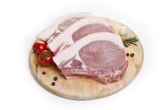 Viande crue sur un fond blanc Images stock