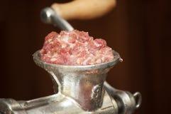 Viande dans le hachoir Photographie stock libre de droits