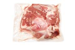Viande de porc fraîche dans l'omoplate emballée sous vide Photo stock