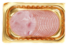 Viande en emballage d'or Photographie stock