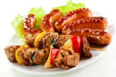 Viande et saucisses grillées Photos libres de droits
