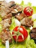 Viande et tomates grillées Image libre de droits