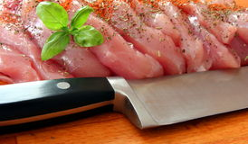 Viande fraîche avec le couteau Images stock