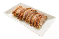 Viande grillée de canard dans le plat blanc Photos stock