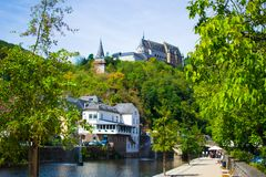 Vianden Castle on a hill with houses and Our river in Vianden, Luxembourg stock photos