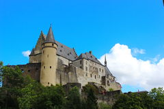 Vianden Castle , Luxembourg. The old and restored Vianden castle on a blue sky background , Luxembourg, Europe Royalty Free Stock Photos