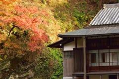 Vibrant Autumn foliage & Old Japanese House Stock Photo
