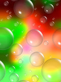 Vibrant Background with Bubbles wallpaper. A vibrant blurred background of yellow, green, and red with transparent bubbles of varying sizes for use in website Royalty Free Stock Images