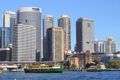 Vibrant big city at harbor. Neutral picture of a vibrant big city at the harbor with ferry boats leaving the quay. Public transport in Sydney, Australia stock photo