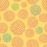 Vibrant block print waffle textured red, blue, green circles Seamless vector pattern on rich yellow background. Perfect royalty free illustration