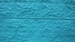 Vibrant blue colored brick wall royalty free stock image