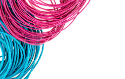 Vibrant blue and pink string rope with white copyspace Stock Images