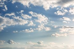 Vibrant blue sky with white clouds. Beautiful nature background.  Royalty Free Stock Photo