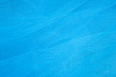 Vibrant Blue Tulle Background Stock Images