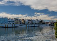 The vibrant Calle Betis seen from side of the golden tower stock photos