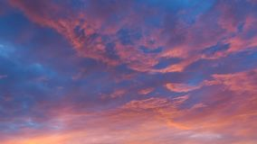 Vibrant clouds at sunset. Vibrant colorful clouds at sunset Stock Image