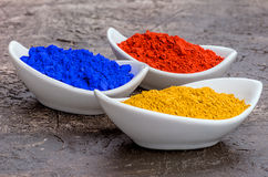 Vibrant color pigments in bowls Stock Images