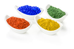 Vibrant color pigments in bowls. Vibrant color pigments in porcelain bowls Stock Photography