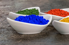 Vibrant color pigments in porcelain bowls Royalty Free Stock Photography