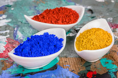 Vibrant color pigments in porcelain bowls on a palette Royalty Free Stock Images