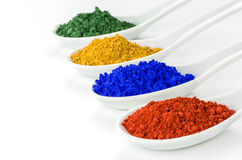 Vibrant color pigments in spoons. Vibrant color pigments in porcelain spoons Stock Photography