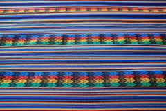 Vibrant color striped pattern of Peruvian fabric for texture. Background or banner royalty free stock photo