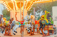 Vibrant colored carousel with lights and horses, close up, outdoor near beach, seaside Royalty Free Stock Photos