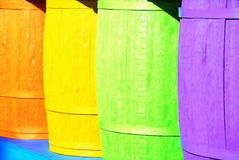 Vibrant Colored Wooden Barrels in a Row Royalty Free Stock Images