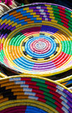 Vibrant colored woven baskets, containers and plates for sell on Royalty Free Stock Photo