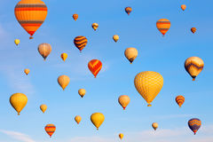 Vibrant colorful air balloons in blue sky. Stock Photography