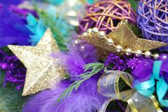 Vibrant Colorful Cristmas or Carnival Background with Golden Stars, Fir Branches. Selective Focus. Royalty Free Stock Image