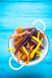 Vibrant colorful rainbow carrots in colander Stock Photo