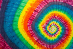Vibrant and Colorful Tie-Dyed Swirl. Full Frame of Bright Tie-Dyed Fabric Swirl Using Vibrant Colors, Ideal for Image Backgrounds Royalty Free Stock Photos