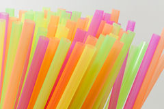 Vibrant colors drinking straws plastic type. Colorful plastic straws used for drinking soft drinks, fresh juices, smoothies which are using in hotels and Royalty Free Stock Photo