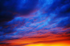 Vibrant colors by dramatic sky. The vibrant colors of a sunset reflected in a thick cloud layer. Dramatic sky Stock Photo