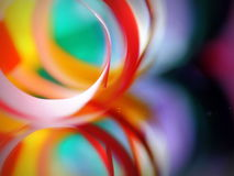 Vibrant coloured paper abstract. Paper links in vibrant, warm colors on a green- blue background Royalty Free Stock Photos