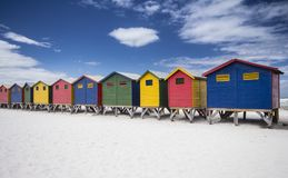 Muizenberg beach huts. Vibrant Coloured wooden beach huts on the beach at Muizenberg, Cape Town Stock Image
