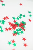 Vibrant Colourful Star Embellishments. Green and red shiny star embellishments isolated on white background Stock Photo