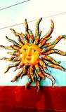 Vibrant and Colourful Sun Face. On  a wooden painted wall Stock Images