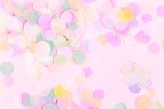 Vibrant confetti on pastel pink background. Festive backdrop for your design stock illustration