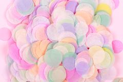 Vibrant confetti on pastel pink background stock images