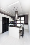 Vibrant cottage - kitchen. Vibrant cottage - interior of modern black and white kitchen Royalty Free Stock Photography