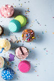 Vibrant cupcakes on blue background, party food concept Royalty Free Stock Image
