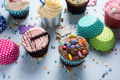Vibrant cupcakes on blue background, party food concept Royalty Free Stock Images