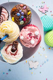 Vibrant cupcakes on blue background, party food concept Royalty Free Stock Photo