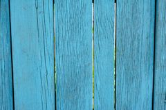 Vibrant cyan blue old wooden planking background with cracks. And splits on it surface stock photos