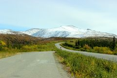 VIBRANT FALL TUNDRA FORREST AND SNOW COVERED HILLSIDE Stock Image