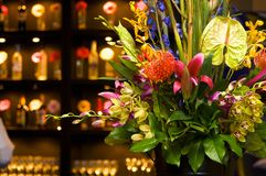 Vibrant flower arrangement in an upscale bar. An image of a vibrant flower arrangement in an upscale bar royalty free stock photography